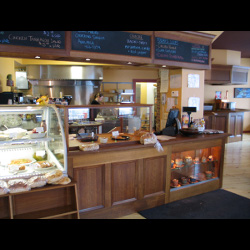 Wraparound Bar, Retail Counter and Bakery Display Cases, in Quarter-sawn, Fumed Oak, Lazy Lion Restaurant